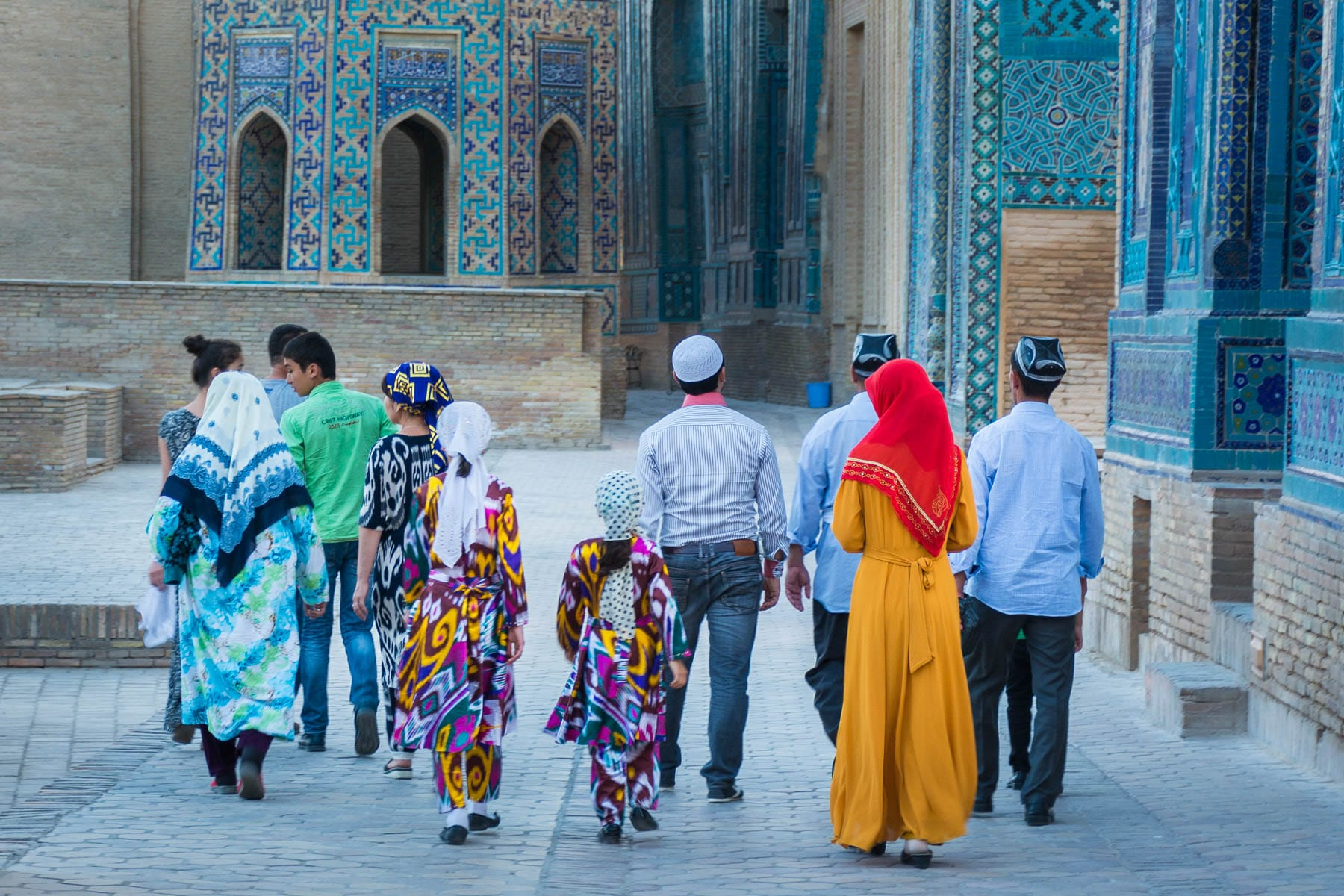 Family walking around in traditional Uzbek clothes in Samarkand -