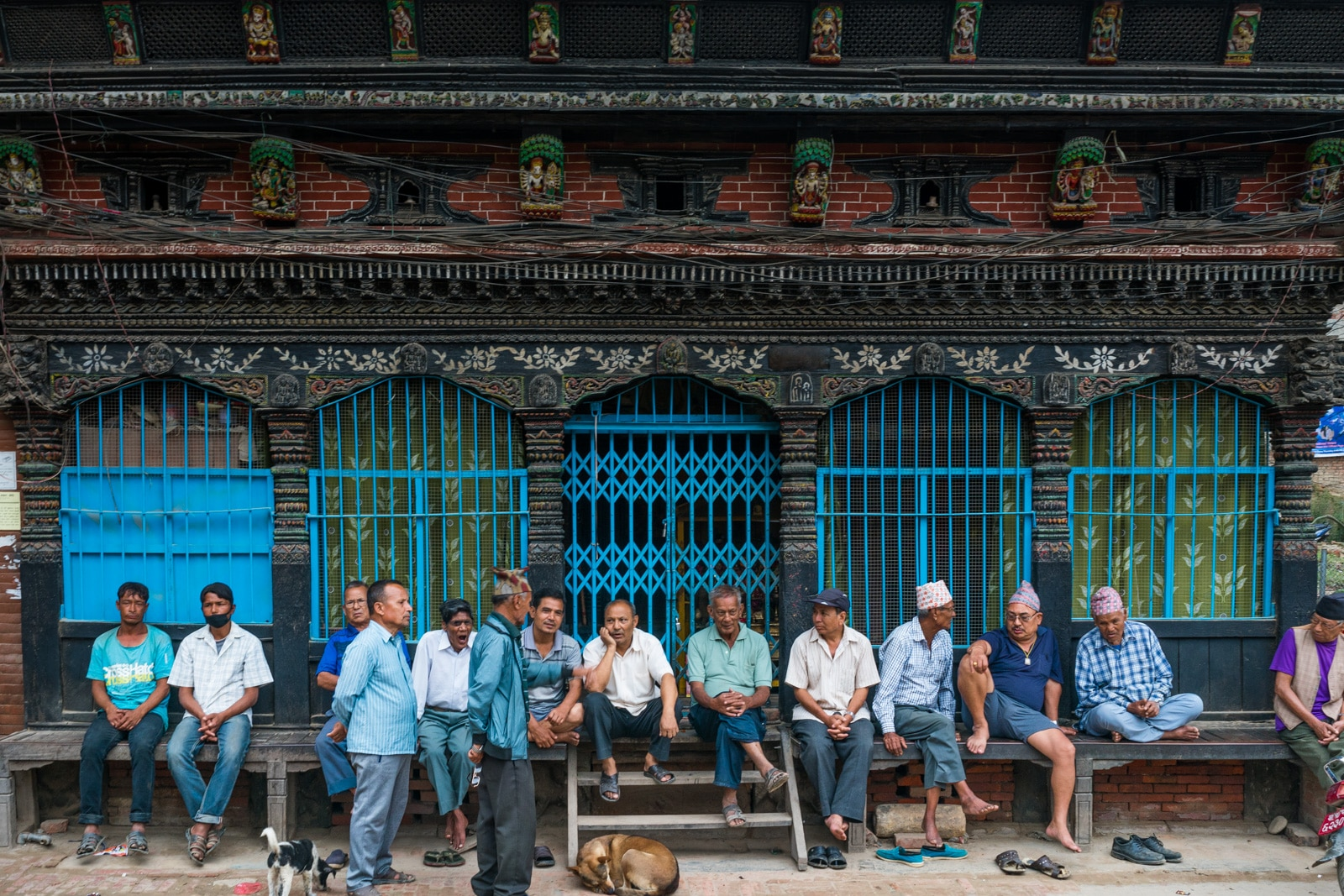 Traveling in Patan, Nepal during monsoon - Men chilling on the streets of Patan - Lost With Purpose travel blog