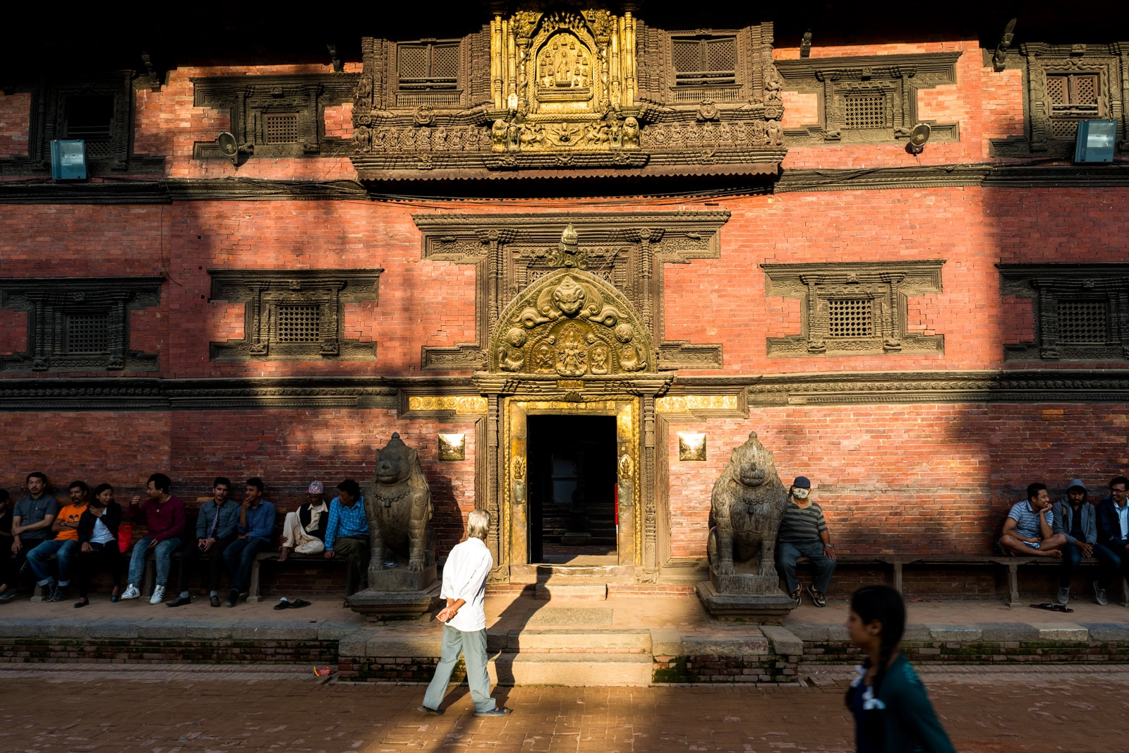 Things to do in Patan, Nepal - A man walking in the Patan Durbar Square - Lost With Purpose travel blog