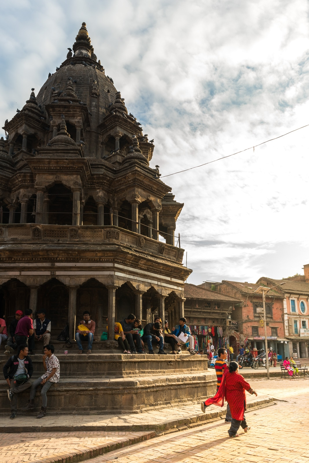 Dramatic lighting during sunset at the famous Durbar Square in Patan, Nepal. Only half an hour from central Kathmandu, Patan's old city is a must visit sight near Kathmandu.