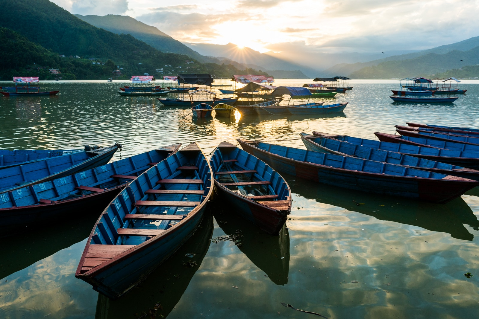 What it's like to travel in Nepal during monsoon - Blue boats on Phewa lake in Pokhara - Lost With Purpose travel blog