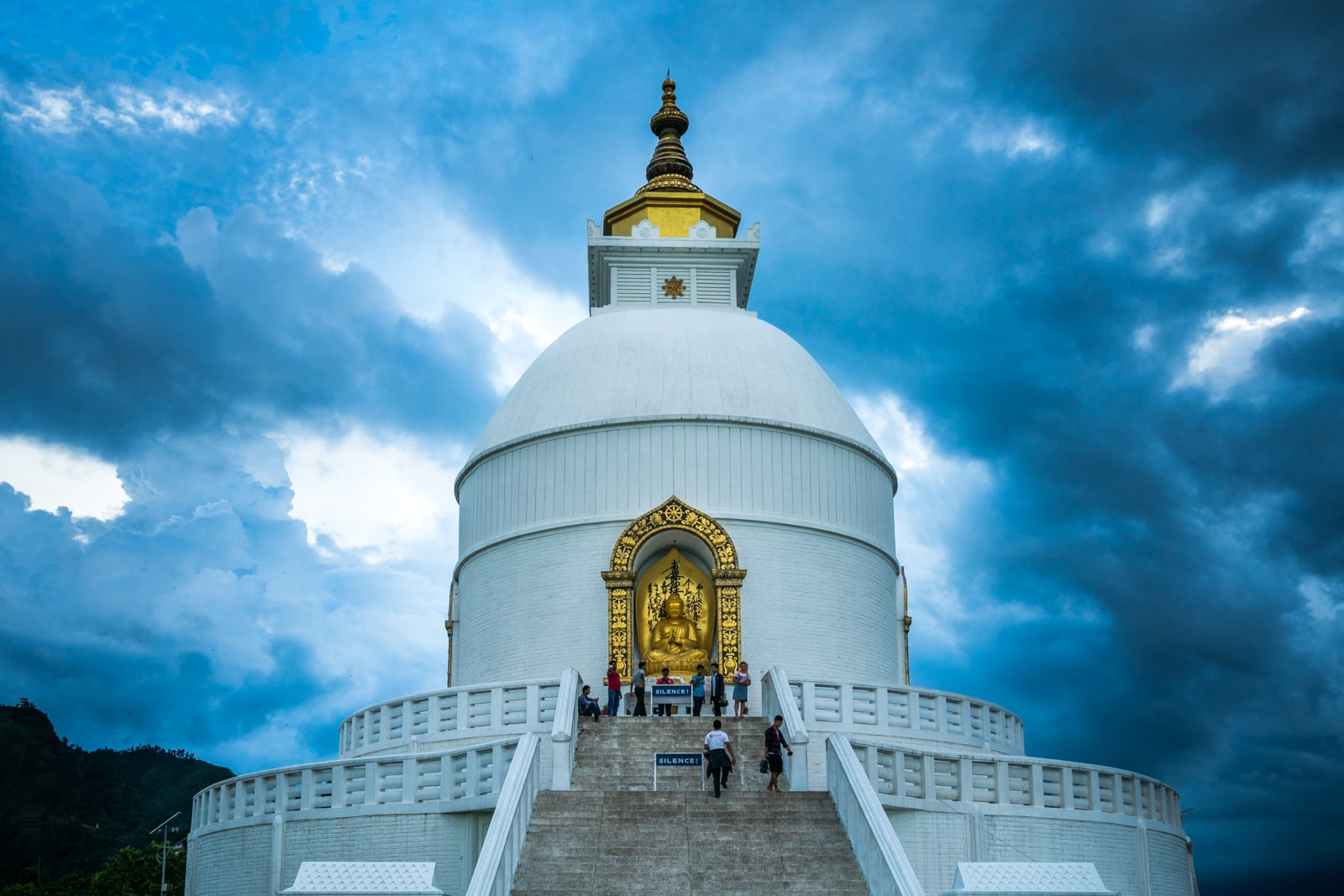 Travel in Nepal during monsoon season - World Peace Pagoda in Pokhara during rain - Lost With Purpose travel blog