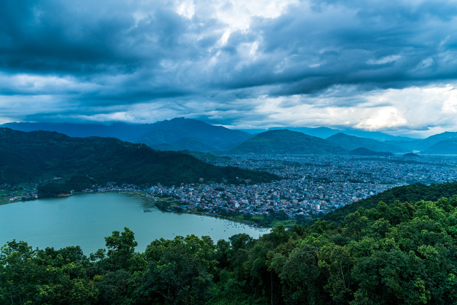 Traveling during monsoon in Nepal, Asia - Rain clouds over the lake at Pokhara - Lost With Purpose travel blog