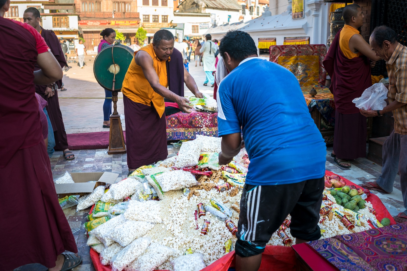 Traveling during monsoon in Nepal - Food donations at Boudhanath temple in Kathmandu - Lost With Purpose travel blog
