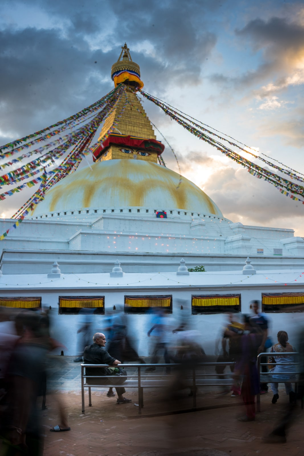 Top places to visit in Kathmandu, Nepal during monsoon - A man sitting still at Boudhanath stupa in Kathmandu - Lost With Purpose travel blog