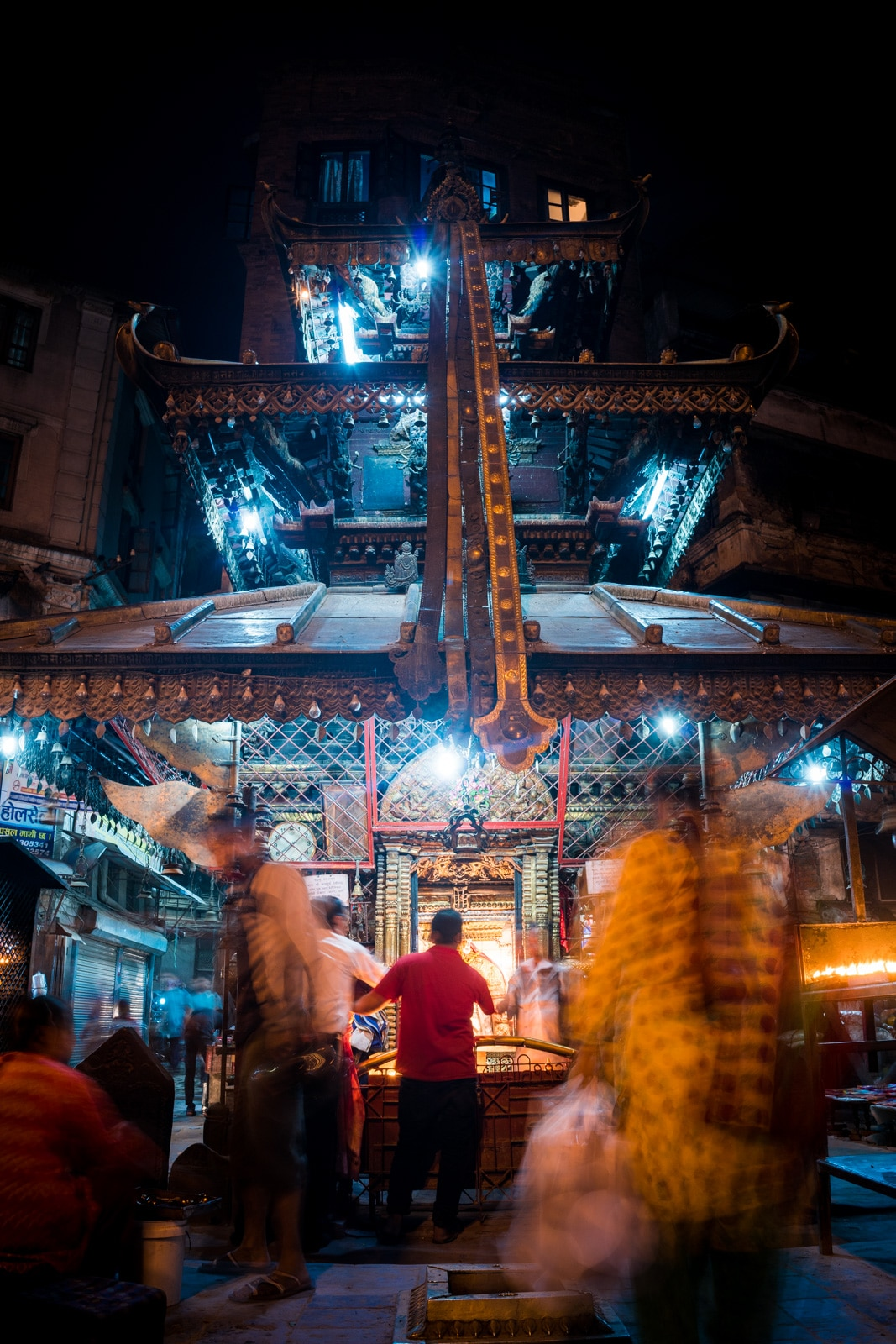 Nighttime activity at one of many Buddhist temples on the streets of Kathmandu, Nepal.