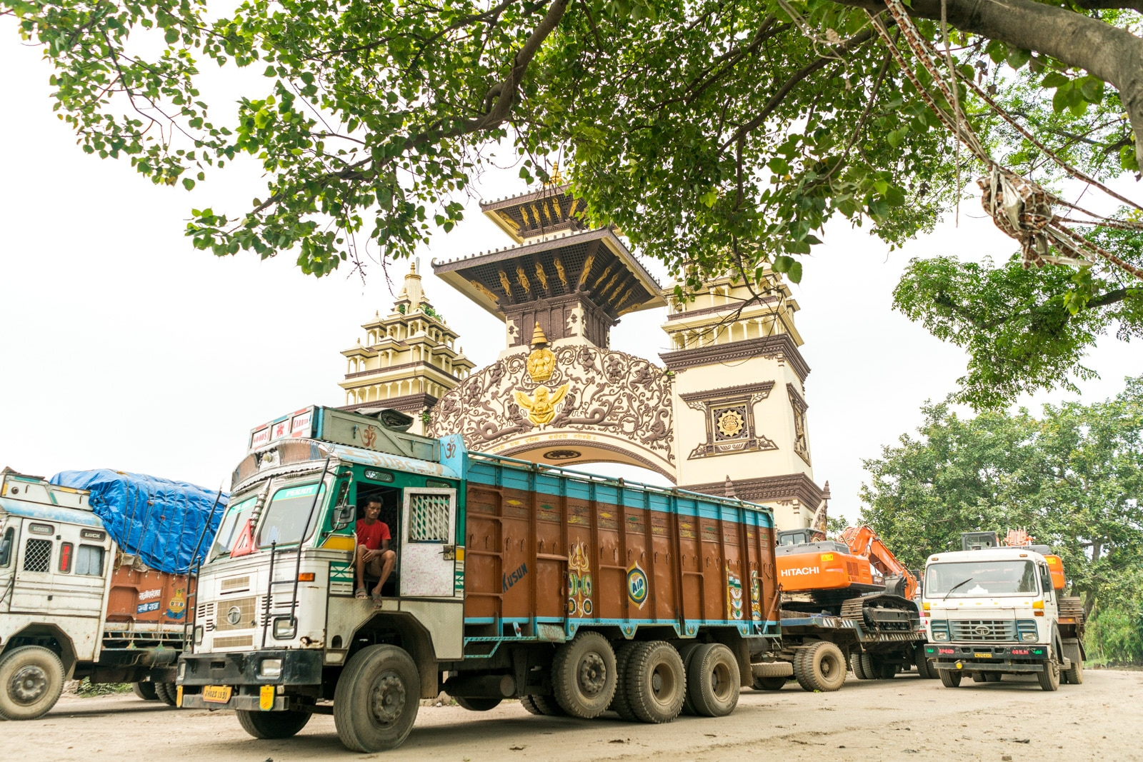 Overland at the Nepal - India border crossing at Birganj and Raxaul - Shipping trucks at the border gate - Lost With Purpose