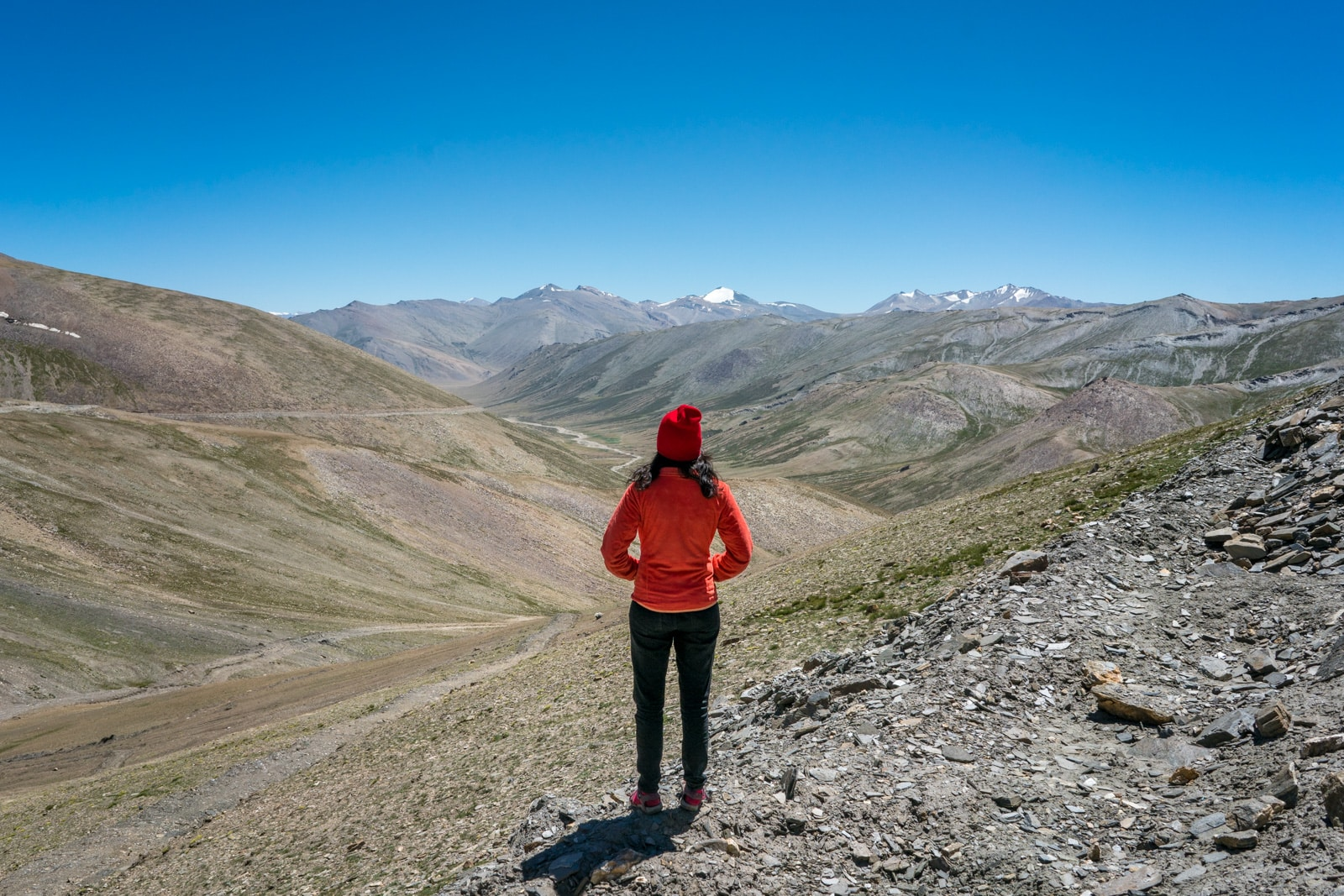 Hitchhiking the Leh - Manali highway - Alex looking over a valley after Taglang La - Lost With Purpose travel blog