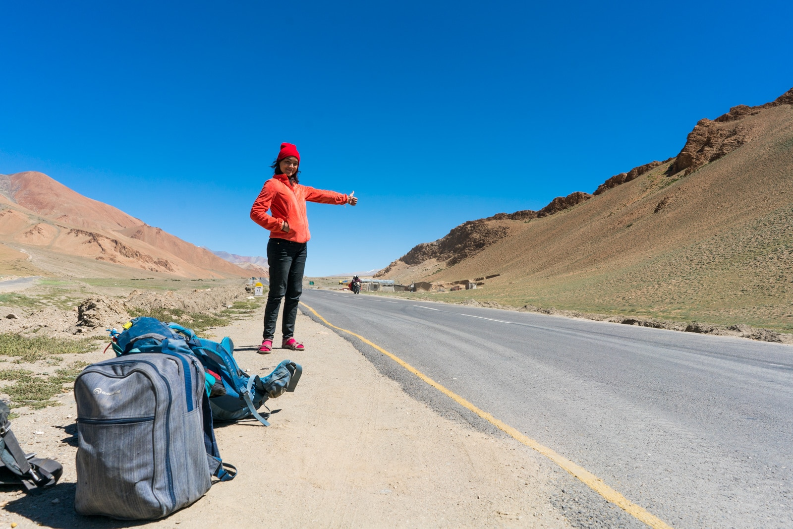Alex hitchhiking the Leh - Manali highway in India - Lost With Purpose travel blog