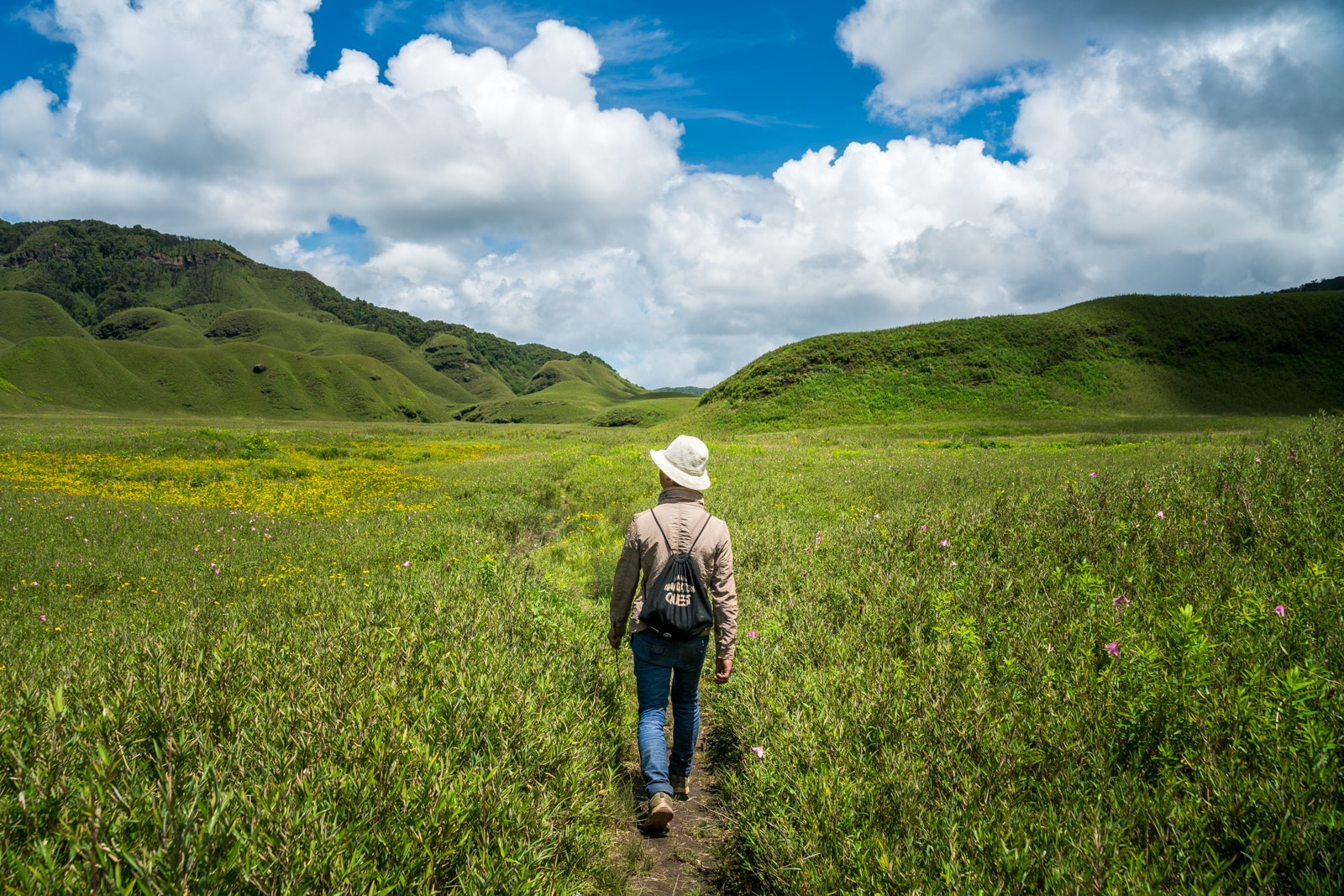 Why you need to travel in Northeast India - Guide walking through the hills of Dzukou Valley in Nagaland and Manipur - Lost With Purpose travel blog