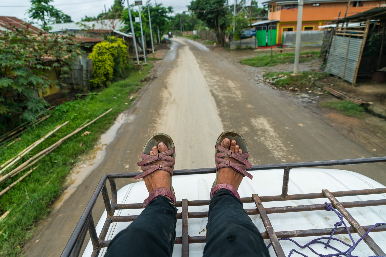 Why you need to travel to Northeast India - Riding on top of a Tempo taxi near Loktak Lake, Manipur - Lost With Purpose travel blog