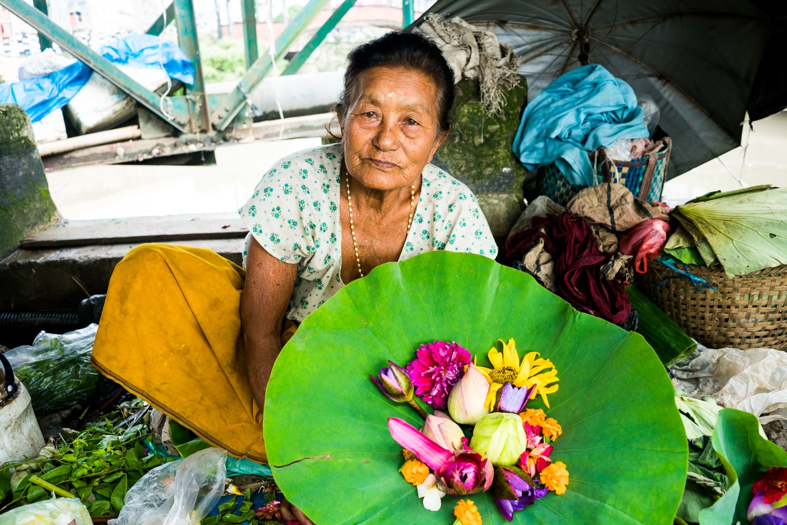 Why you need to visit Northeast India - Flower market woman in Imphal, Manipur - Lost With Purpose travel blog