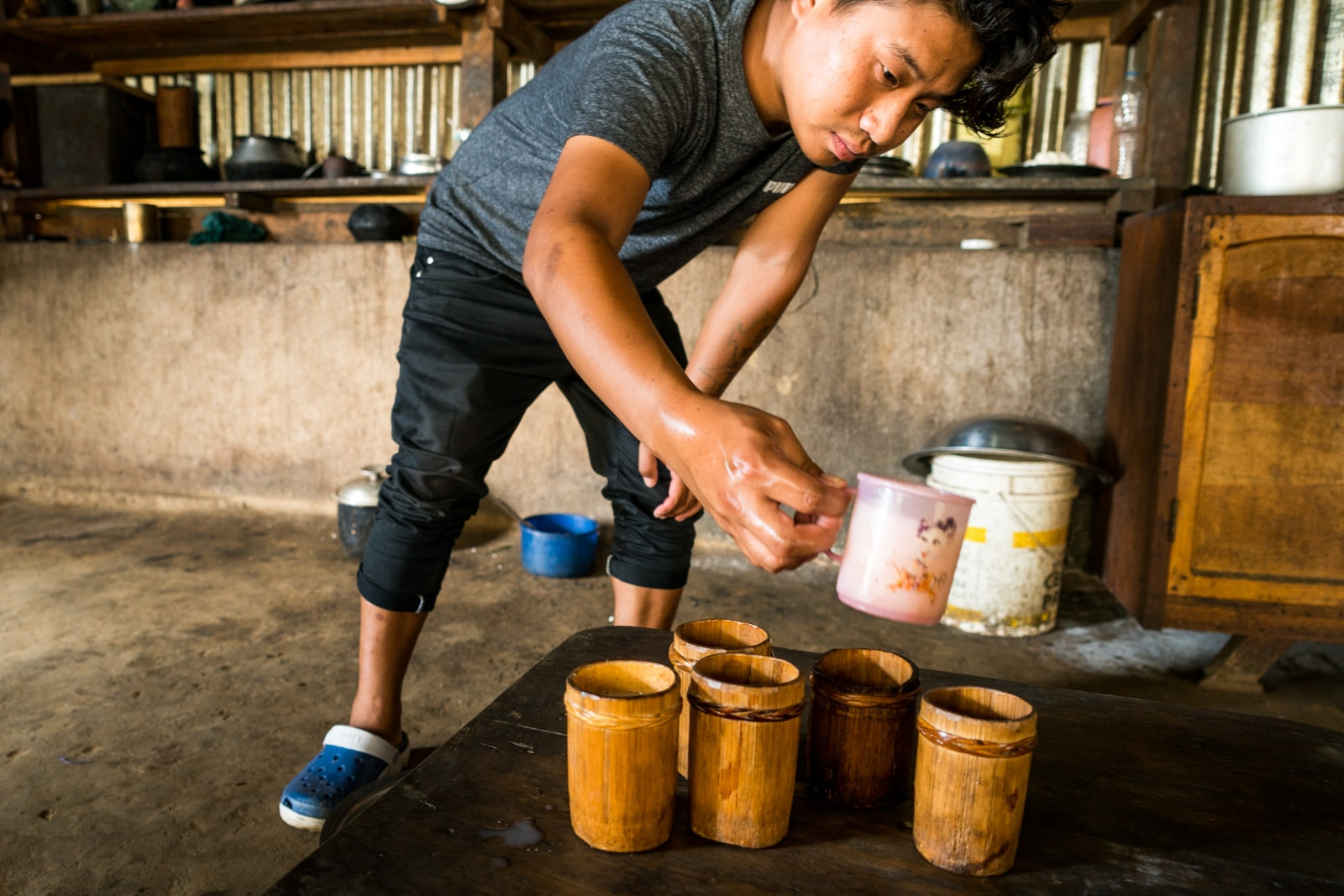 5 reasons to visit Northeast India - Sharing Manipuri yu rice beer with friends - Lost With Purpose travel blog