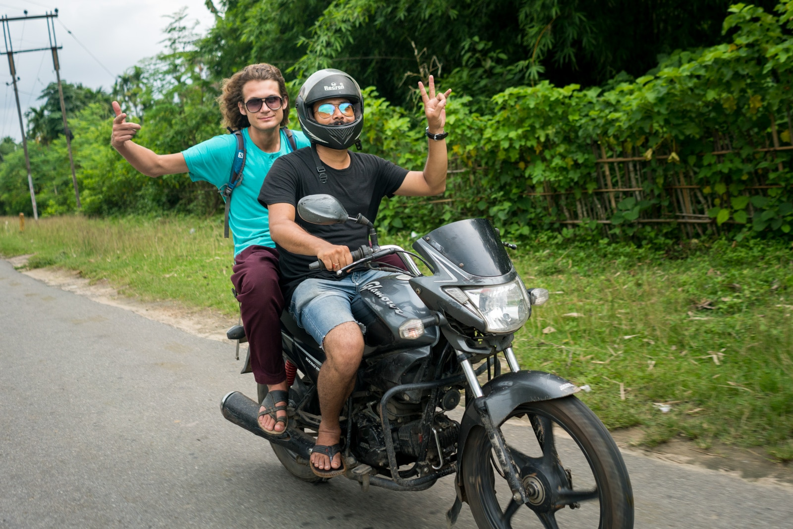 Why you need to travel in Northeast India - Sebastiaan motorbiking around with a friend in Guwahati, Assam - Lost With Purpose travel blog