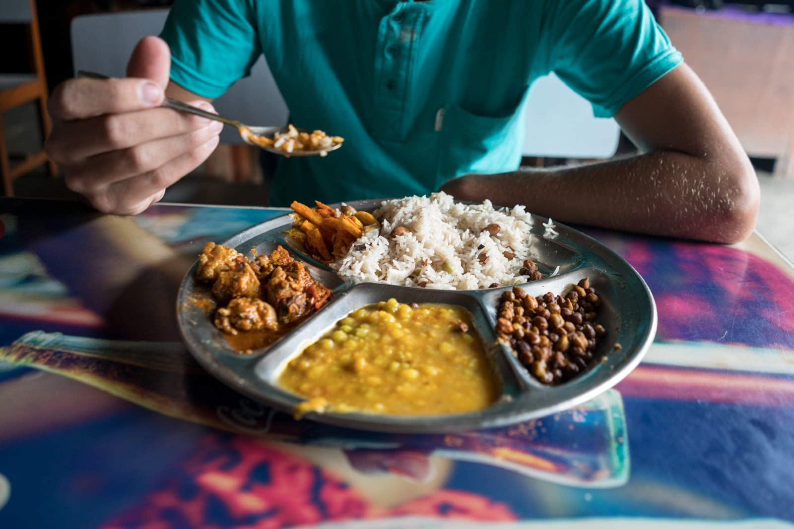 Traveling during monsoon season in Nepal - Dal bhat at a rest stop - Lost With Purpose travel blog