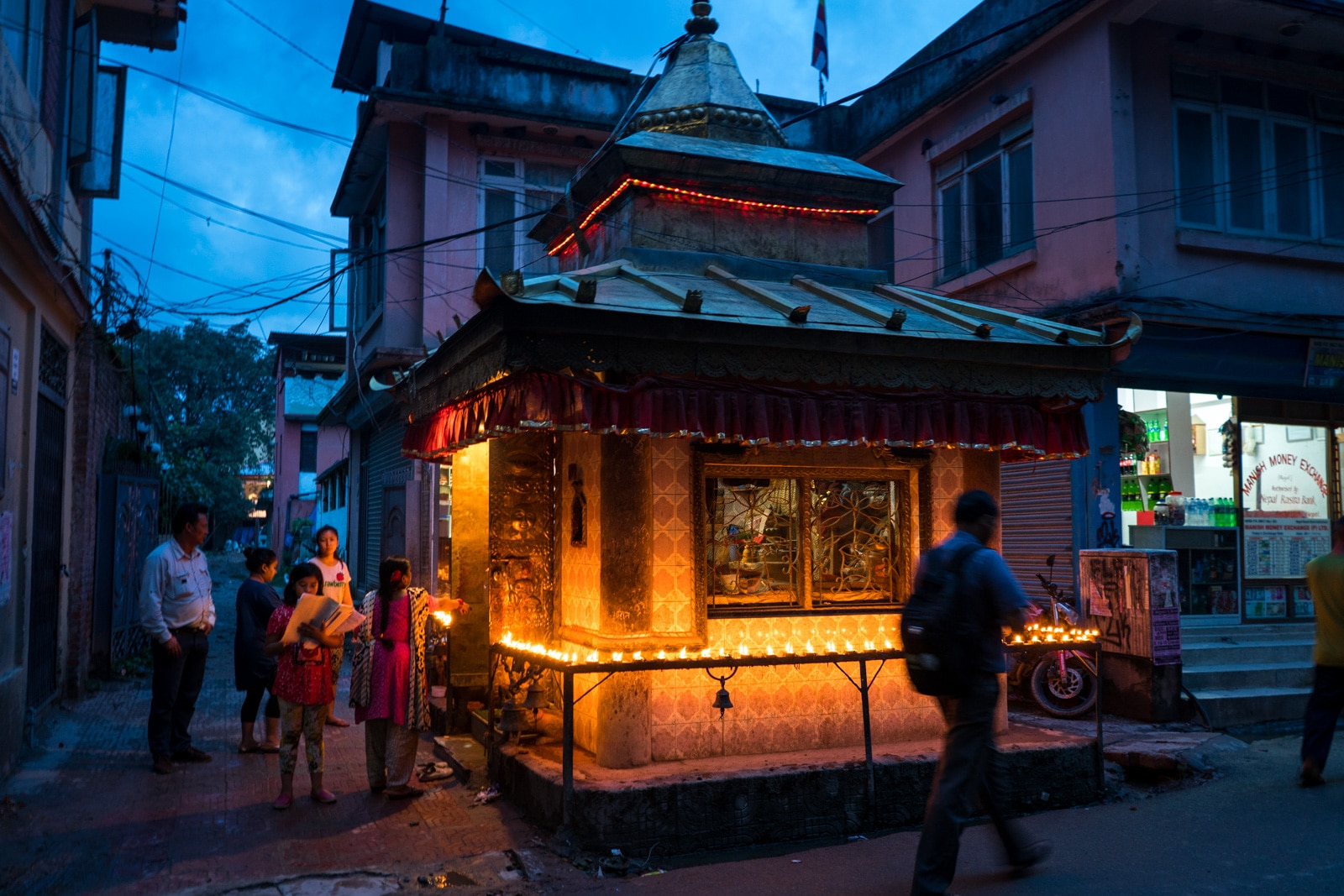 Traveling during Nepal in monsoon - Small Buddhist shrine on the streets of Kathmandu - Lost With Purpose travel blog