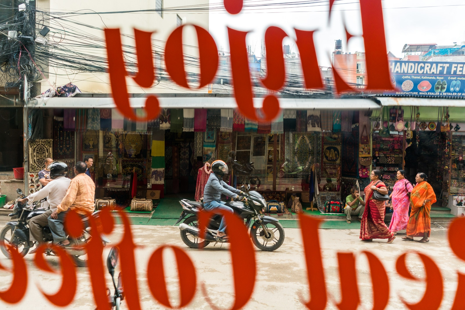 Photos of traveling in Nepal during monsoon season - Streets of Thamel from inside Chikusa Cafe - Lost With Purpose travel blog