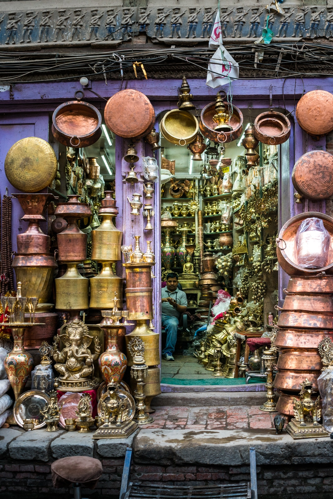 A store filled to the brim with brass and copper knick knacks in the New Market area of Kathmandu, Nepal.