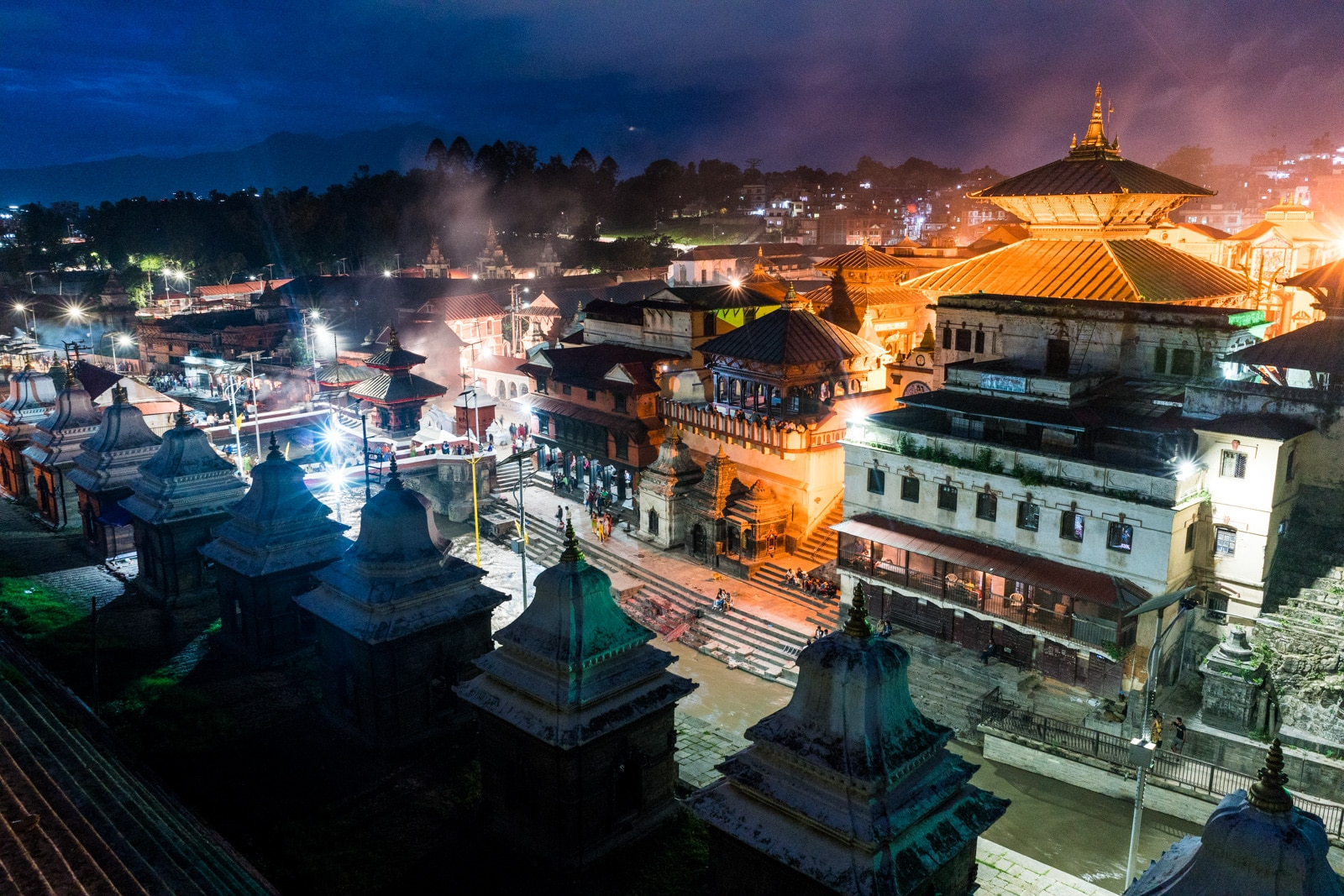 What it's like to go traveling during monsoon in Nepal - Hindu UNESCO Pashupatinath temple in the evening - Lost With Purpose travel blog