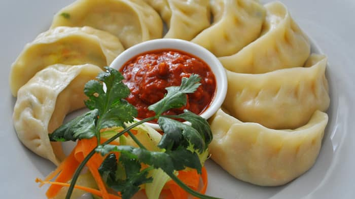 A plate of steamed Tibetan momos - Top 5 must-eat delicacies in Lhasa, Tibet