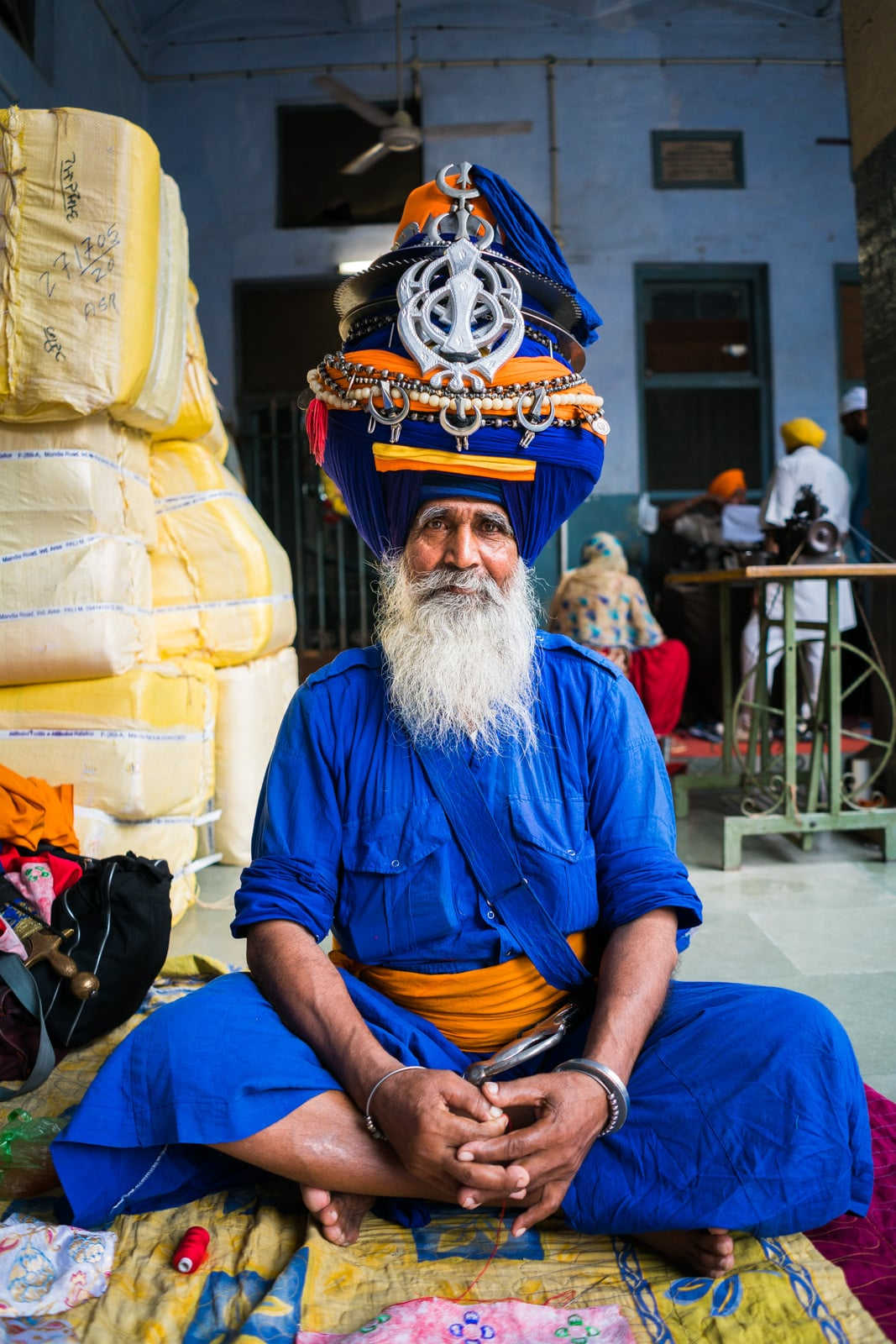 A Sikh man in full regalia sitting in one of the guesthouses around the Golden Temple in Amritsar, Punjab state, India.