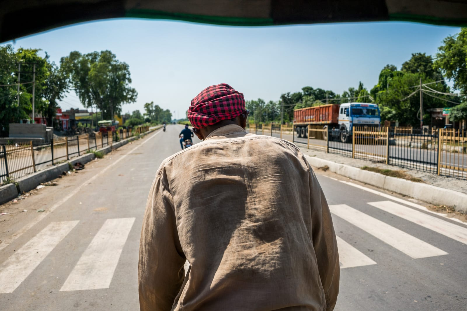 Crossing overland at the Wagah border between India and Pakistan - Cycle rickshaw to the border - Lost With Purpose travel blog