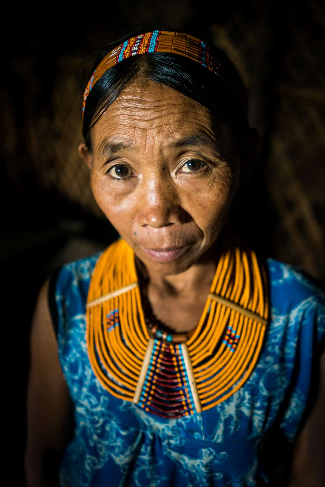 A woman in traditional tribal dress in Longwa Village, Nagaland state, Northeast India.