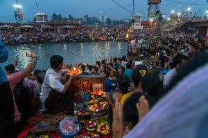 Man doing puja at the Ganga aarti in Haridwar, Uttarakhand, India
