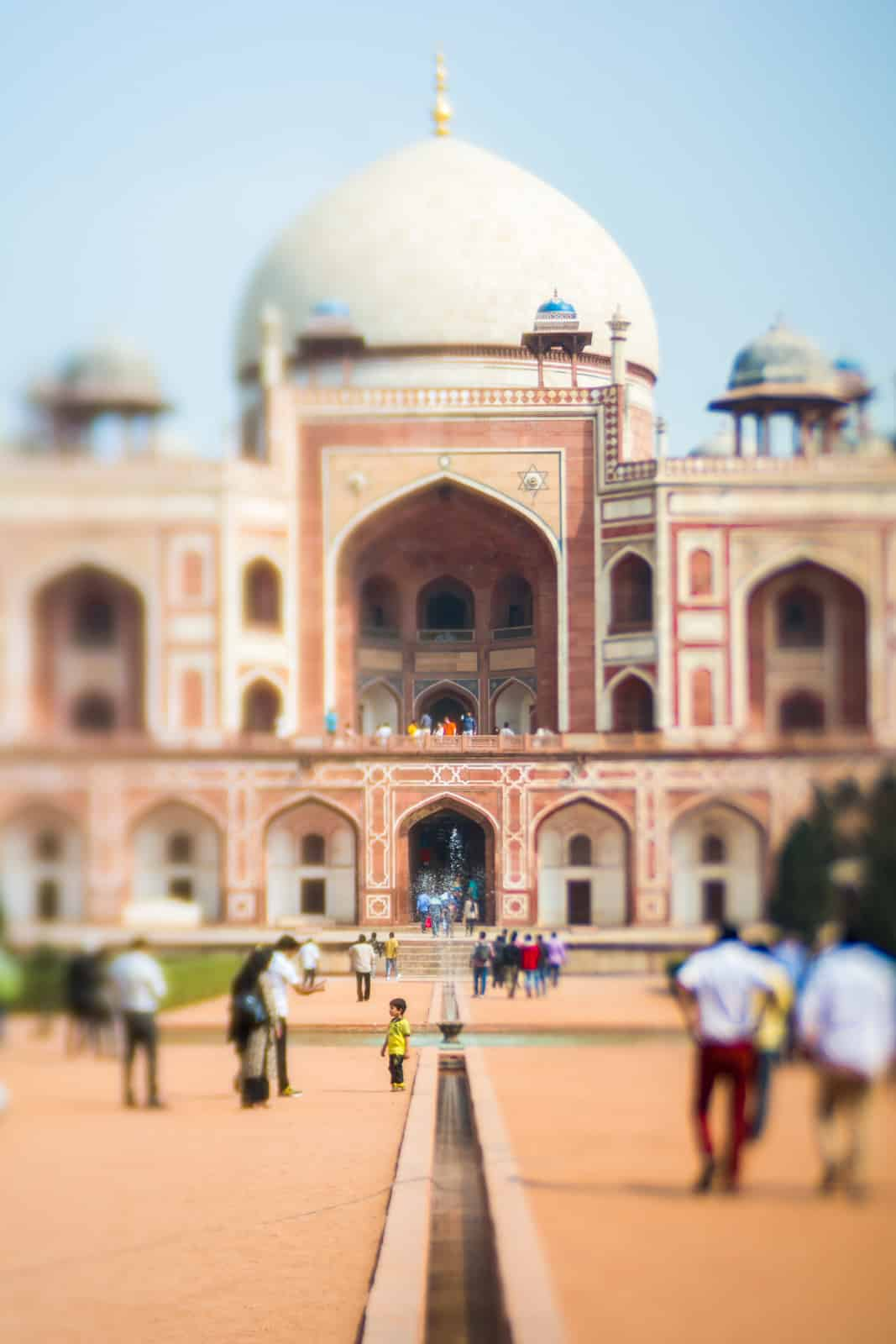 Tourists at Humayun's Tomb in Delhi, India shot with a Lensbaby Edge 50 Optic.