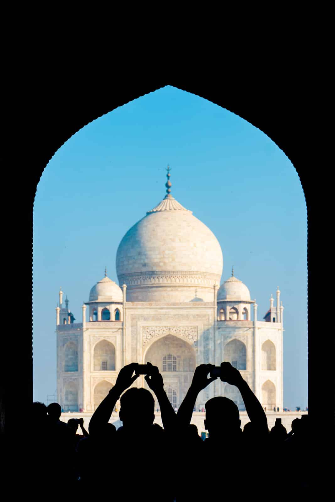 Tourists with cameras at the Taj Mahal in Agra, India.