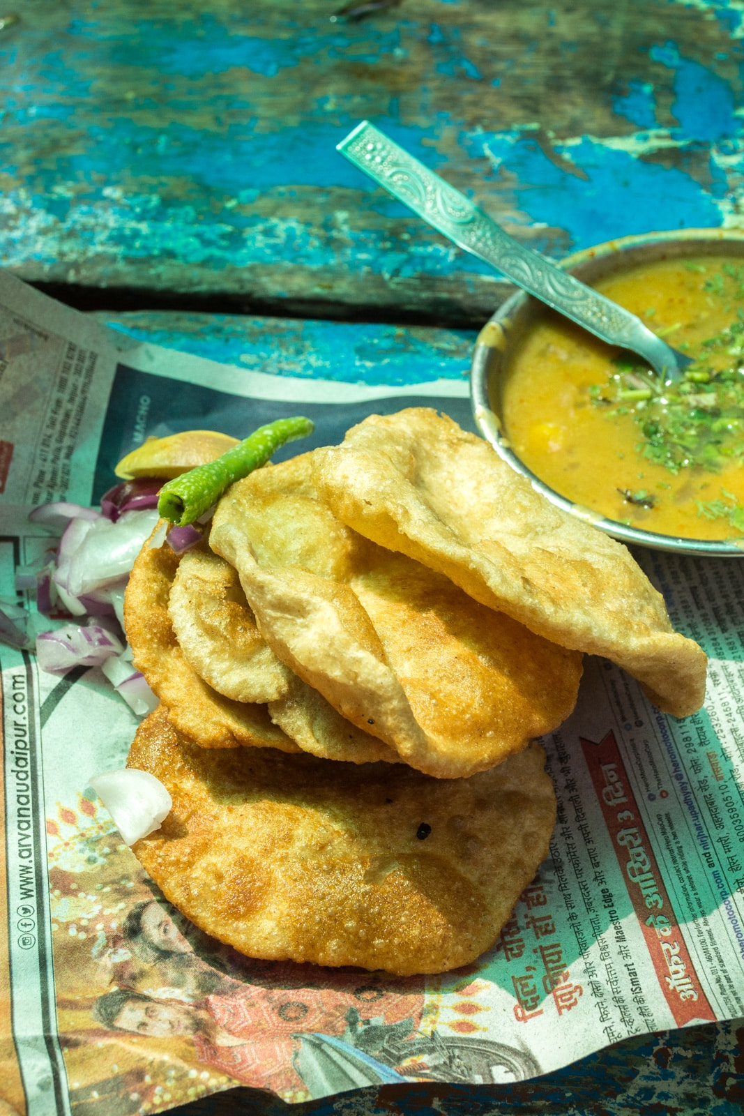 Fresh puri on a newspaper on the streets of Udaipur, Rajasthan state, India.