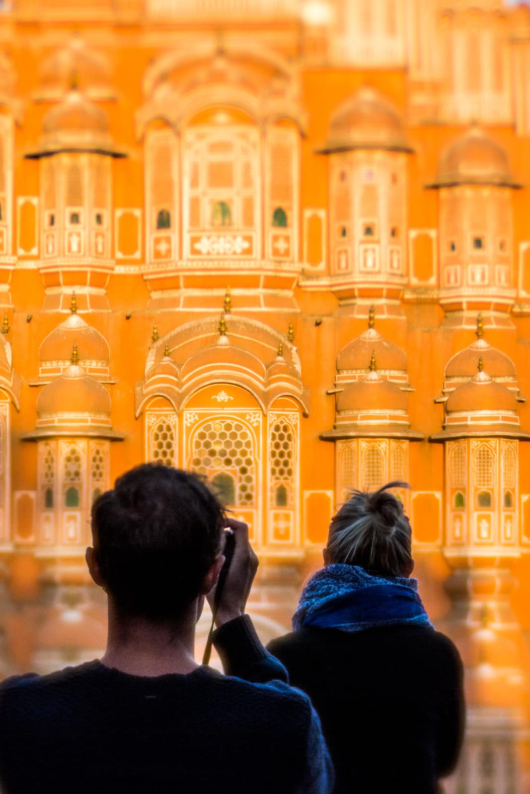 Tourists taking photos in front of the Hawa Mahal in Jaipur, Rajasthan state, India.