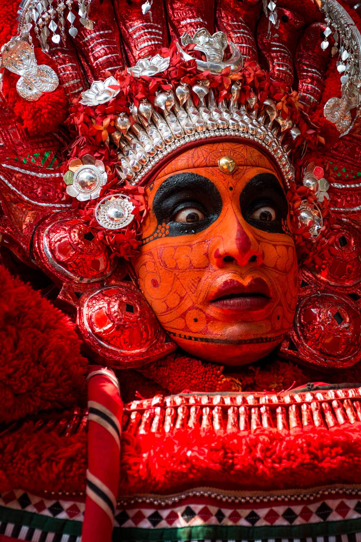 Portrait of a Theyyam dancer in full face paint during Theyyam season in Kannur, Kerala state, India.