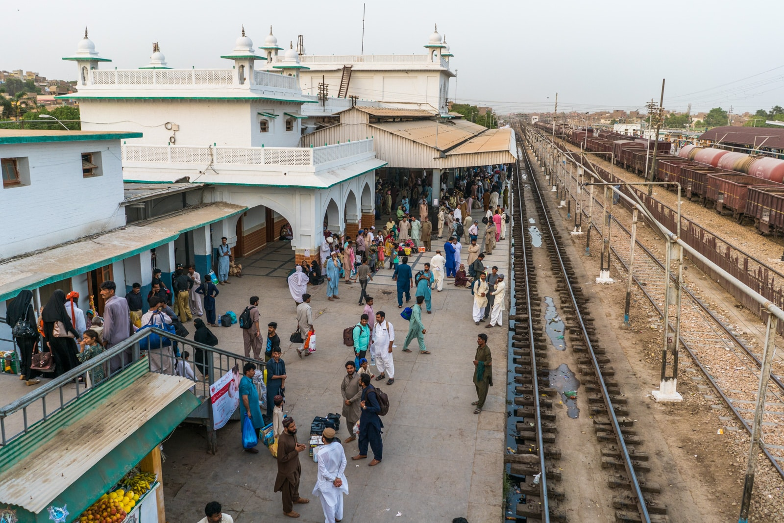 Passengers waiting for train at a train station in Hyderabad, Sindh, Pakistan