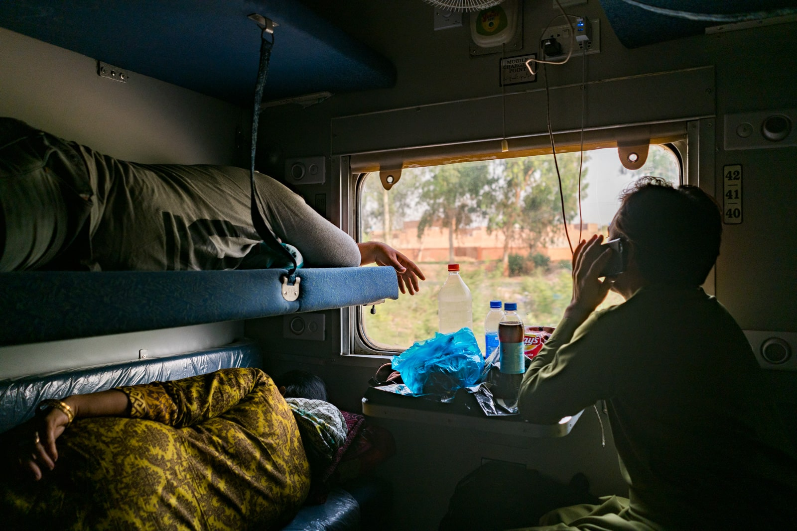 Passengers in AC Sleeper class on a train in Pakistan