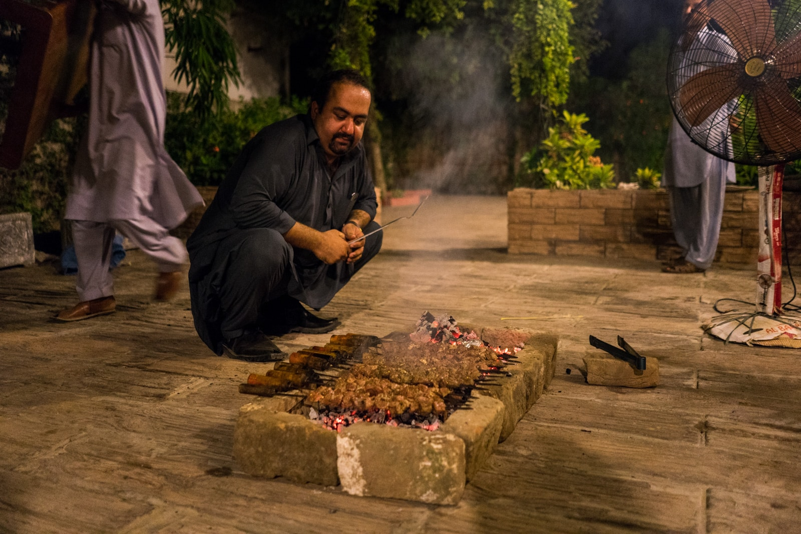 Who are the Pashtuns of Pakistan? - Hamza barbecuing - Lost With Purpose travel blog