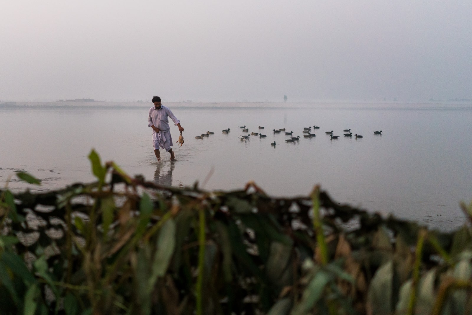 The most hospitable people in Pakistan - Siar running to get ducks from the river - Lost With Purpose travel blog