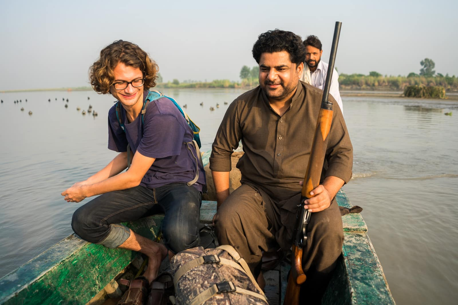 Who are Pashtuns? - Boat ride with a rifle in Mardan, Pakistan - Lost With Purpose travel blog