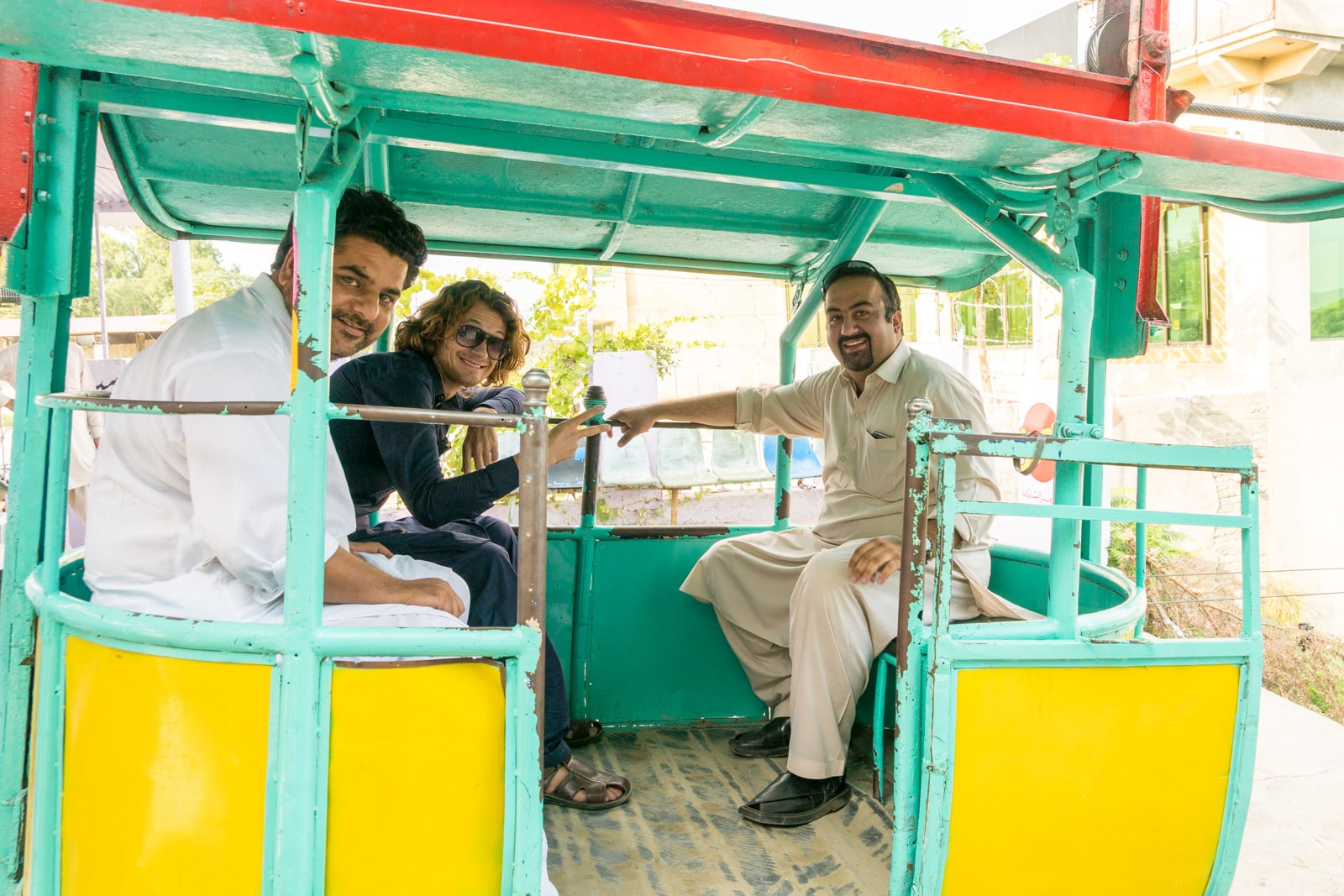 The most hospitable people in Pakistan - Group shot in a cable car over Kabul river - Lost With Purpose travel blog