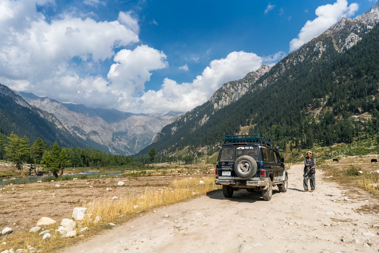 A driver standing next to his Jeep enroute to Kumrat Valley in Pakistan