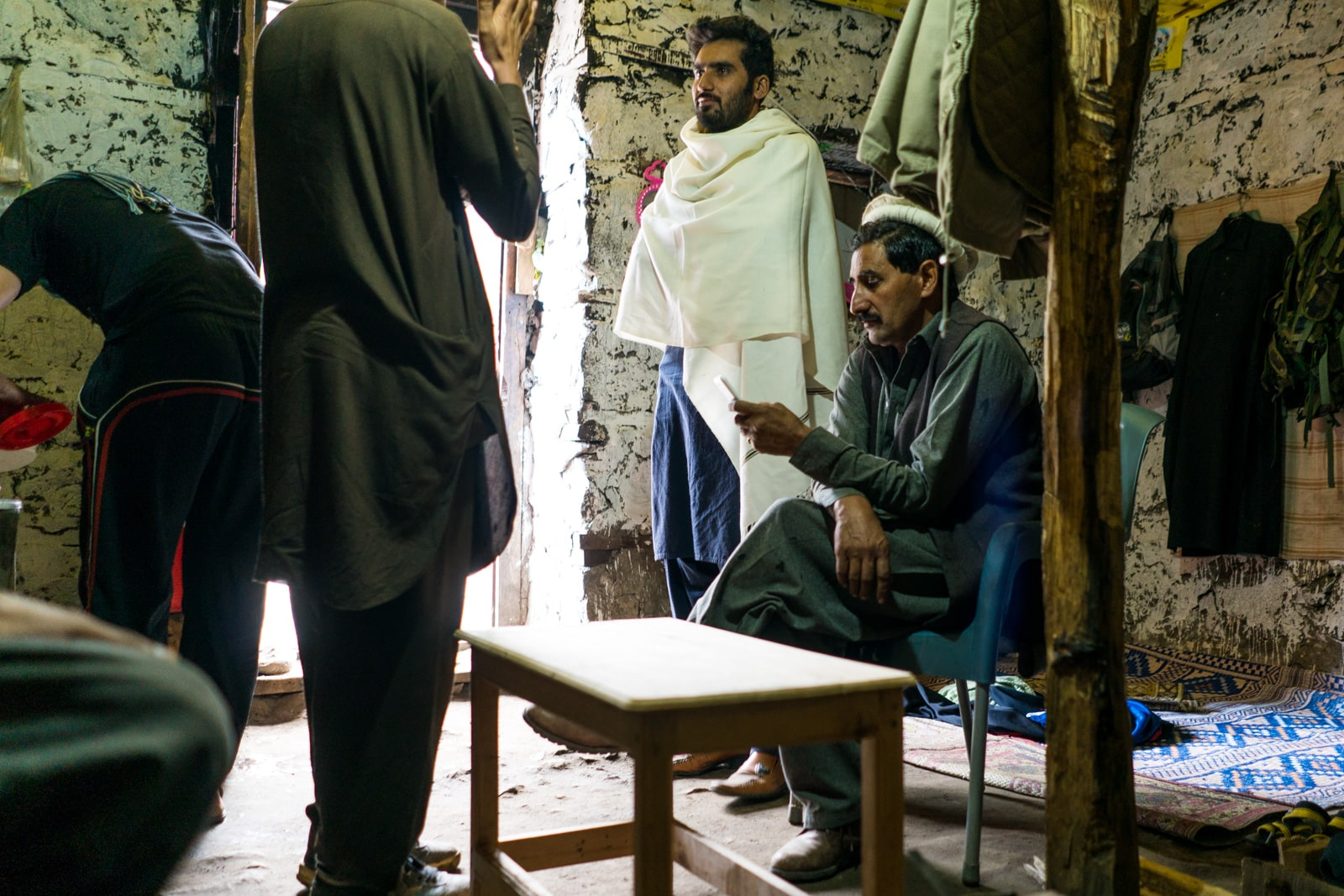 Men sitting at the army checkpoint at the entrance of Kumrat Valley in Pakistan