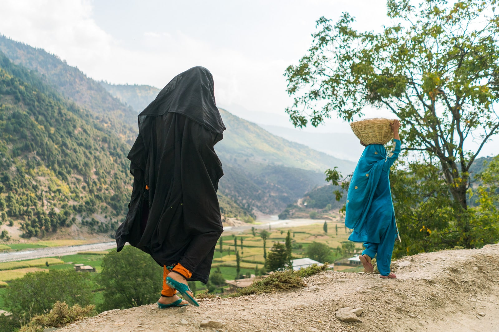 The great divide in Thall, Pakistan - Woman walking in black - Lost With Purpose travel blog