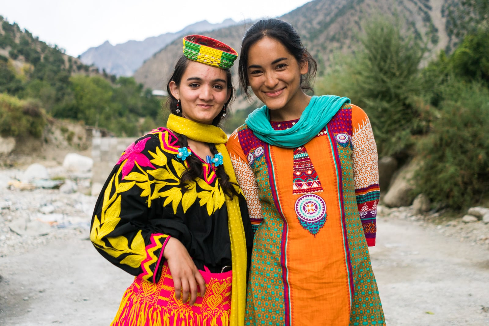 Foreign visitor posing with a Kalasha girl