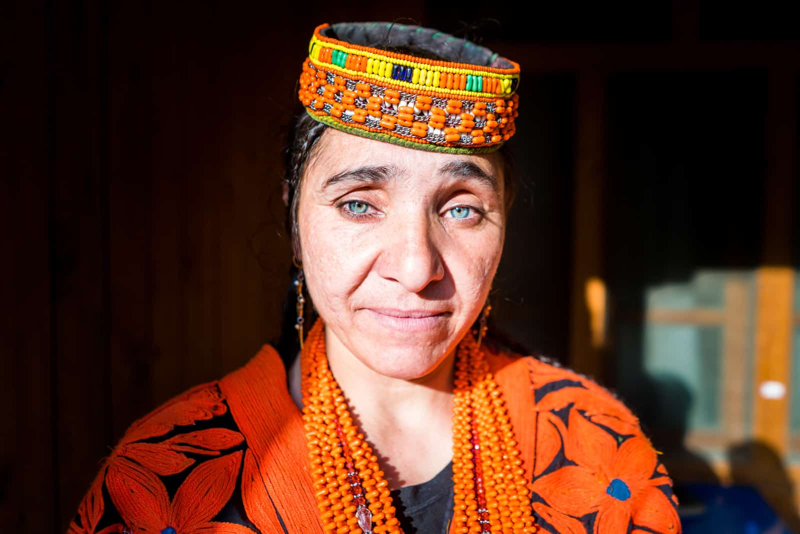 Kalasha woman with blue eyes in traditional outfit