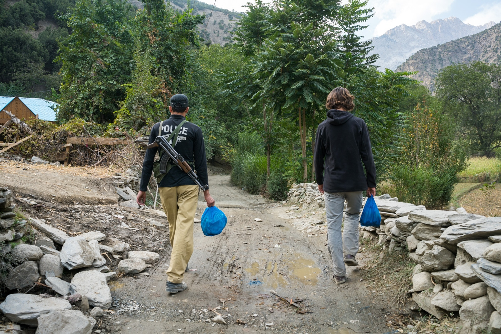 How to get from Chitral to Kalash Valleys in KPK, Pakistan - Foreigner security police escort in Kalash Valley - Lost With Purpose travel blog