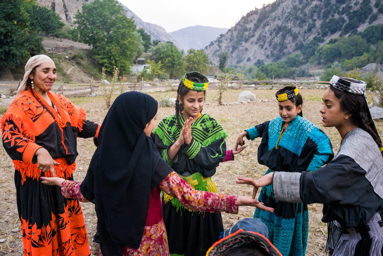 Kalasha girls in traditional outfit playing games