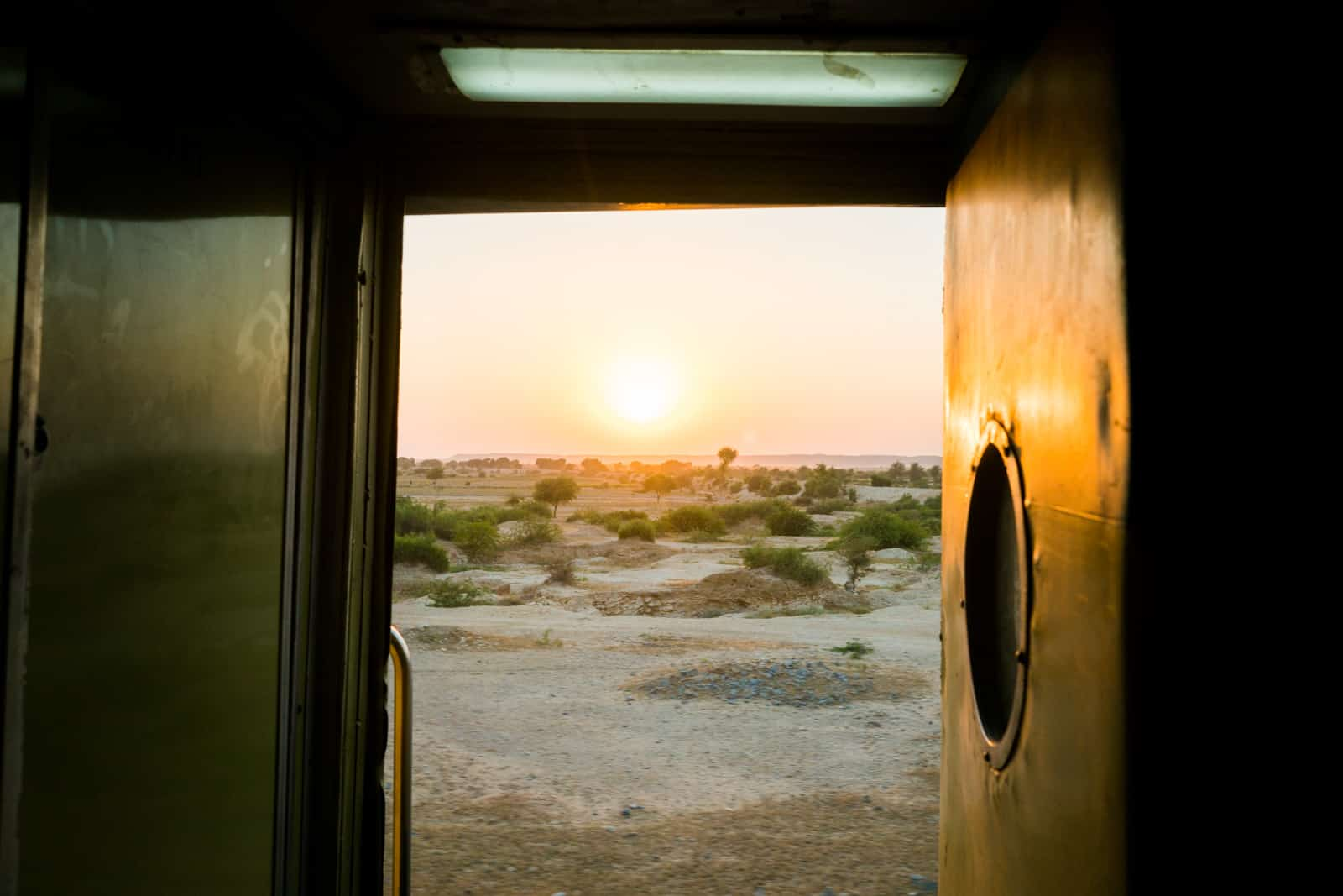 How to buy train tickets in Pakistan - Sunsets from the train in the desert of Sindh - Lost With Purpose travel blog