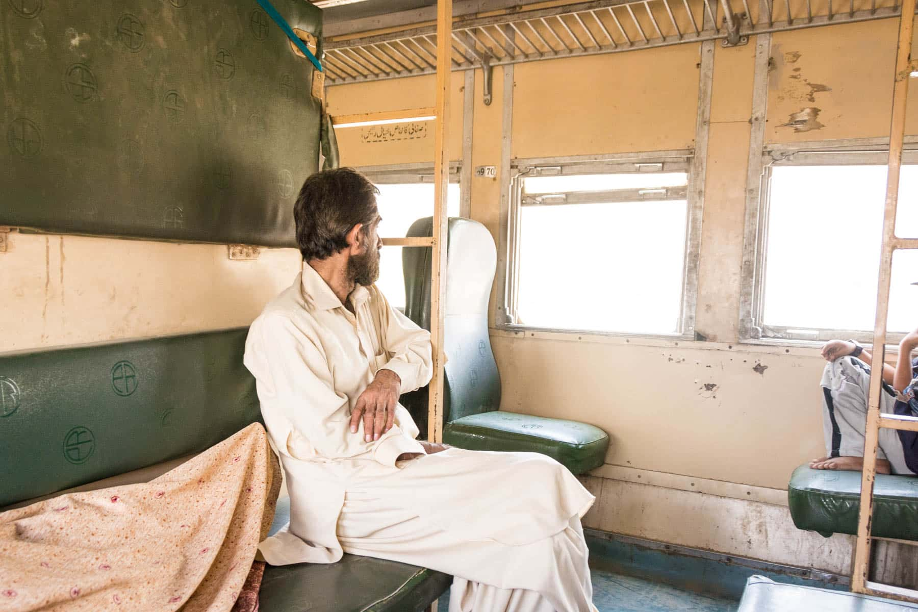 Guide to train travel in Pakistan - Economy standard train class - Lost With Purpose travel blog