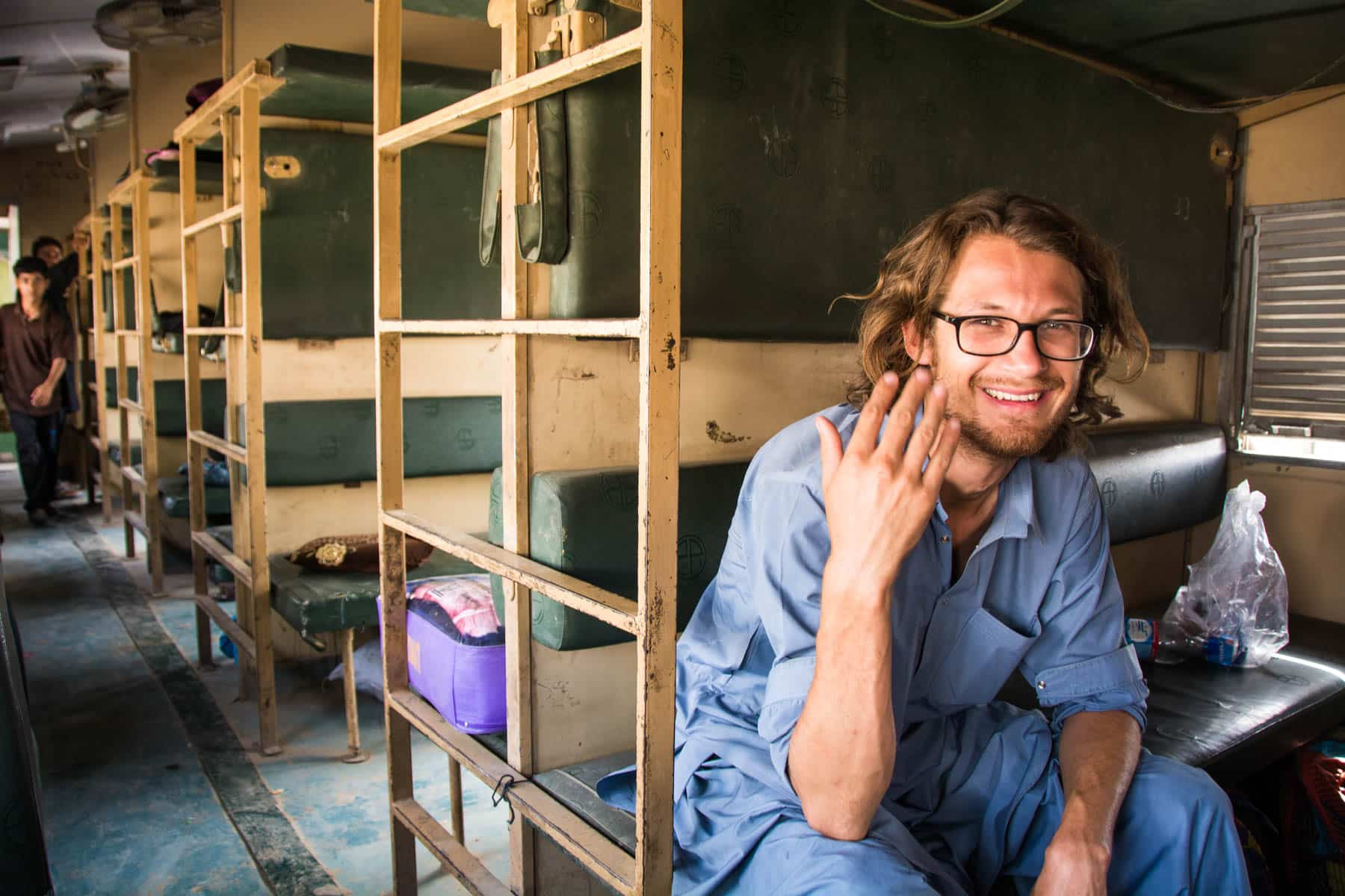 Guide to train travel in Pakistan - Melting in non-AC train class - Lost With Purpose travel blog