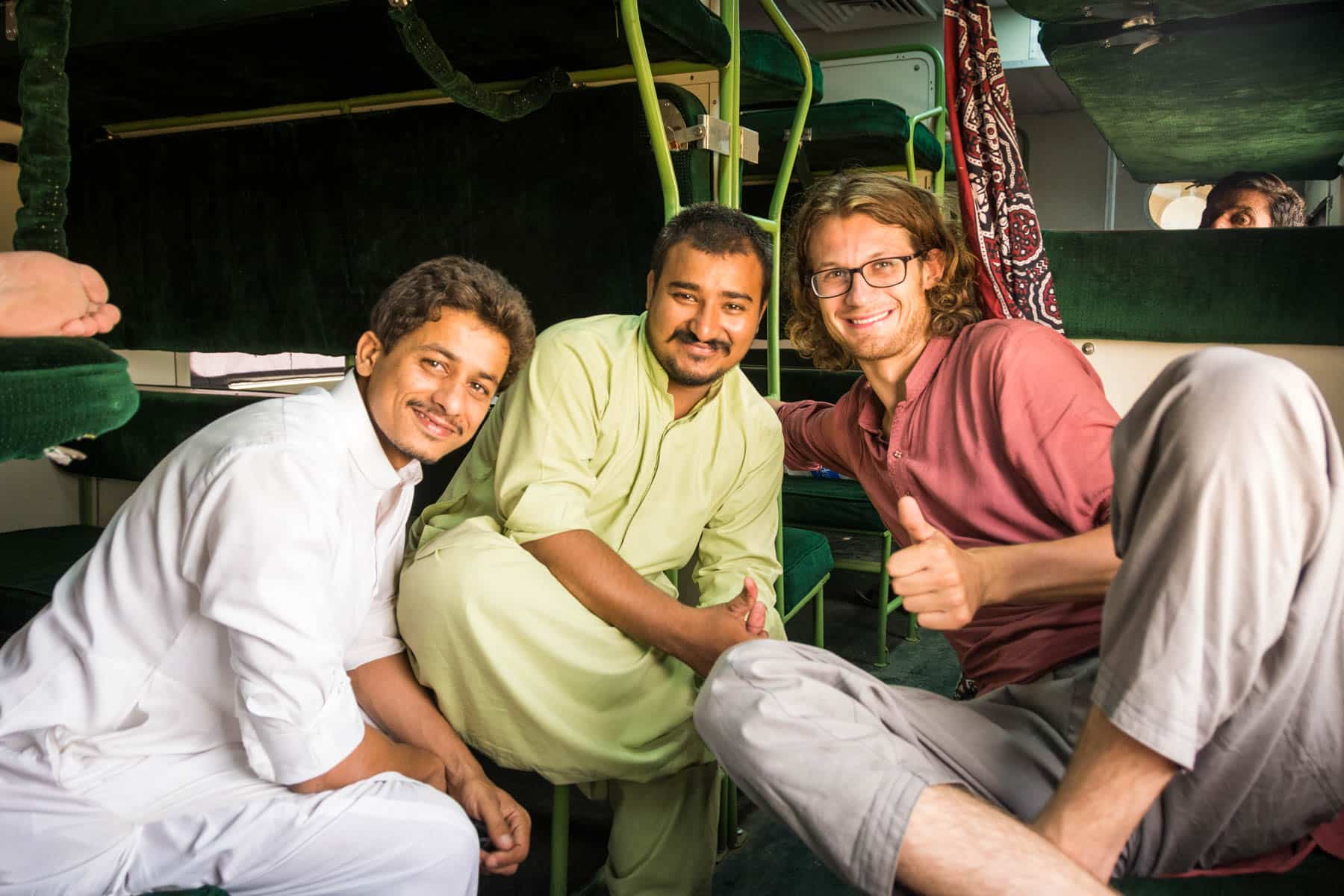 Guide to train travel in Pakistan - Making friends on the train - Lost With Purpose travel blog